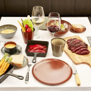 Meat by weight, garnishes, sauces and wine at Solomillo Restaurant